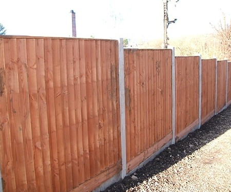 Closeboard panels in concrete posts