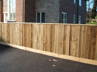 Featheredge fence with gravelboard and capping
