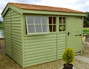 Green wooden garden shed
