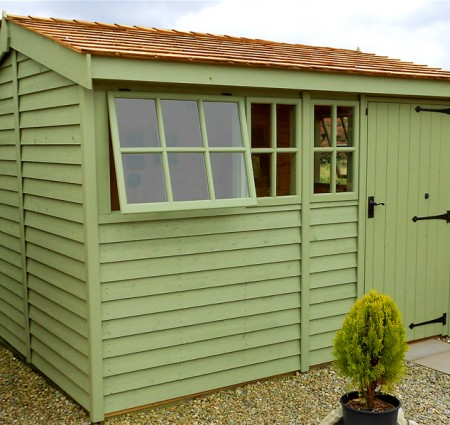 Green wooden garden shed