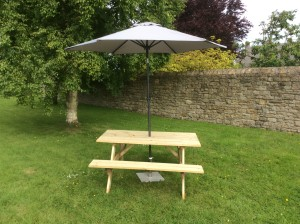 Parasol and picnic bench