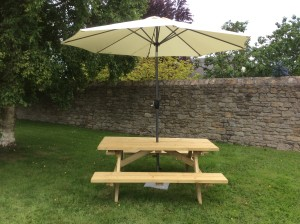 Picnic bench with umbrella