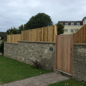 Fencing above stone wall