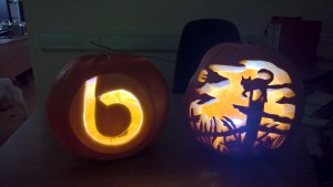 John Bright b and cat scene carved in pumpkin