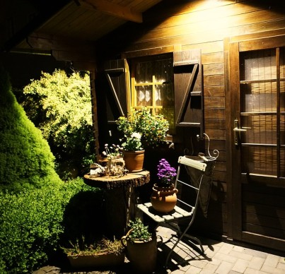 Shed at night with table and chairs outside