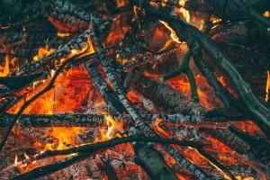 Piles of wooden sticks burning