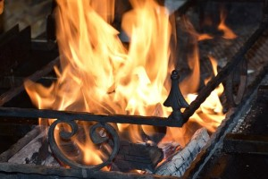 log fire buring in iron grate