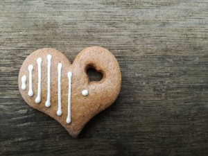 Gingerbread heart decorated with icing stripes