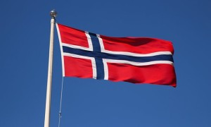 Norway flag flying on flagpost