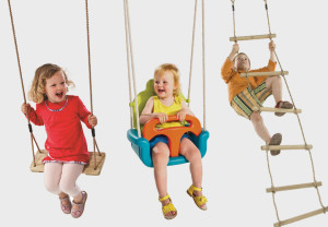 Children in swings and on rope ladder
