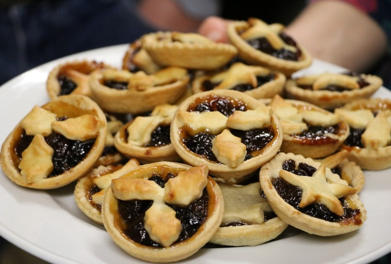 Mince pies with holly pastry decoration