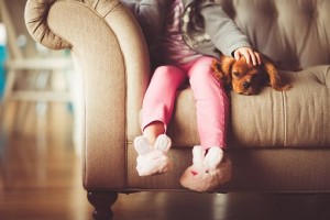 Girl sitting with puppy