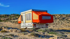 Caravan with red pop out in desert