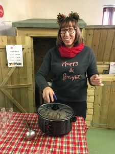 Beth Bright serving mulled apple juice