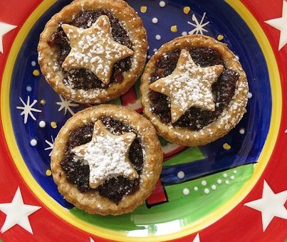 three mince pies on a star plate