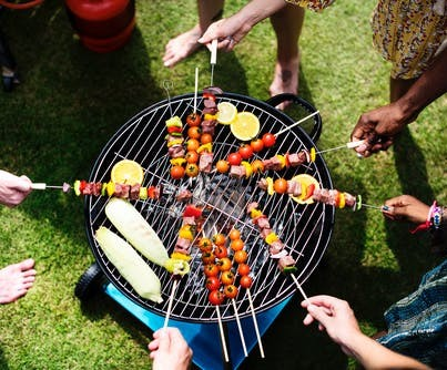 People around a barbecue