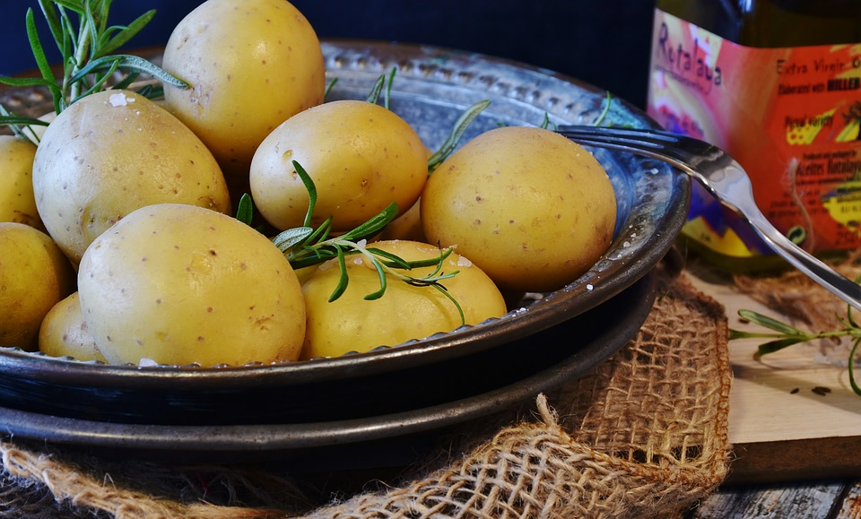 Bowl of new potatoes garnished with rosemary