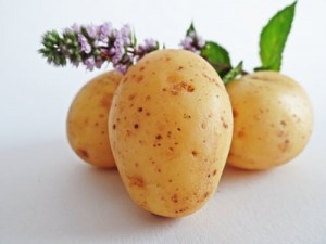 New potatoes garnished with rosemary and mint