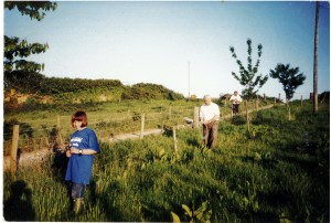 Beth as a child, helping with fencing