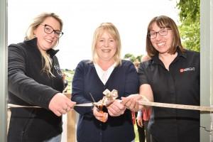 Women cutting ribbon