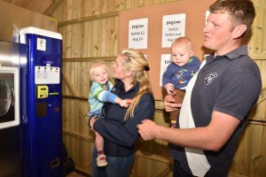 Family buying milk from vending machine
