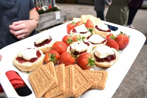 Tray of scones, strawberries and biscuits