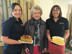 Three women with cakes