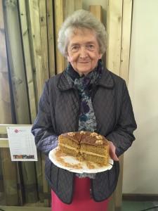 Lady holding cake