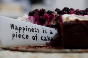 Happiness is a piece of cake slogan on cake