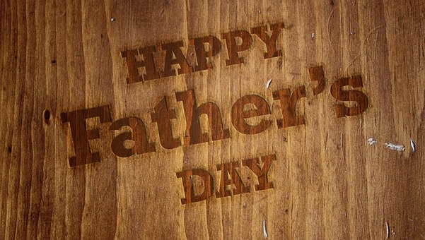 Happy Father's Day message on wooden board