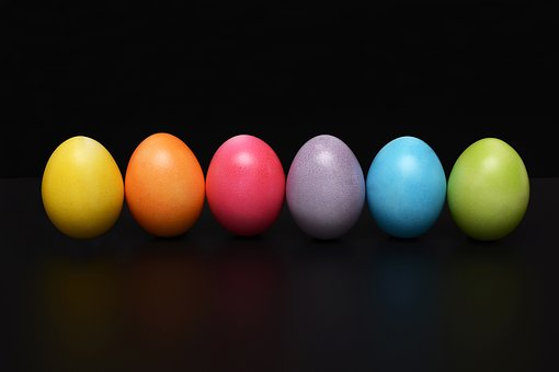 painted eggs in a row