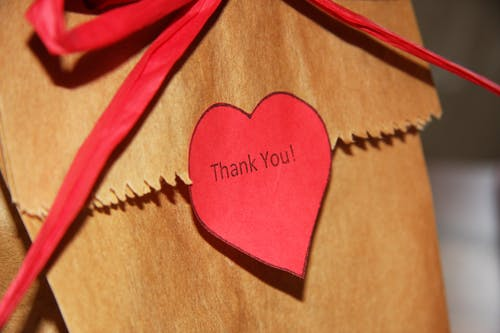 Thank you red heart sticker on bag